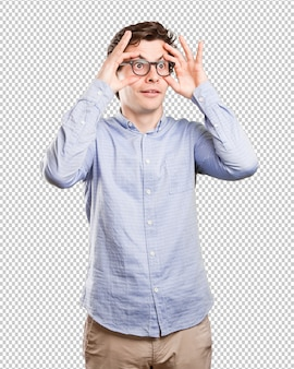 Surprised young man with an observe gesture