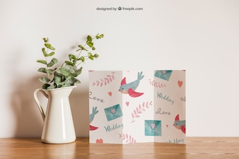 Trifold paper next to flower