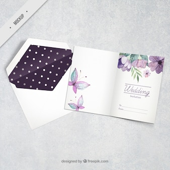 Watercolor floral wedding invitation with butterflies
