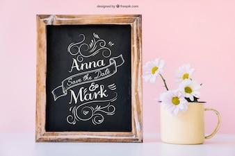 Wedding decoration with slate next to mug