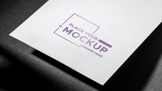 White paper business card mock-up dark background