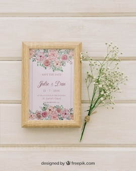 Wooden frame and bouquet of flowers