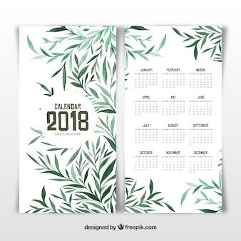 2018年のカレンダーと緑の葉