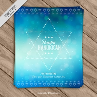 Abstract hanukkah greeting card with bokeh effect