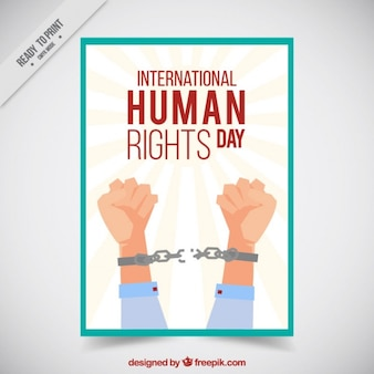 Arms breaking a chain for human rights day