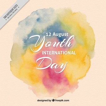 Artistic youth day background with watercolor stains