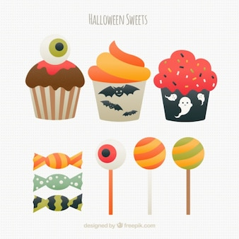 Assorted muffins and halloween candies