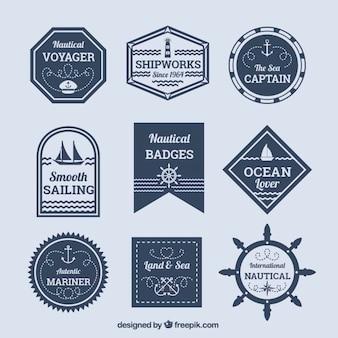 Assortment of decorative nautical badges in flat design