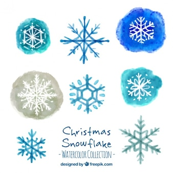 Assortment of decorative snowflakes painted with watercolor