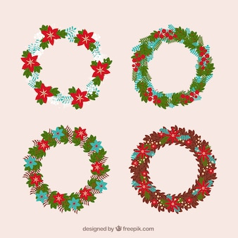 Assortment of flat christmas wreaths with red flowers