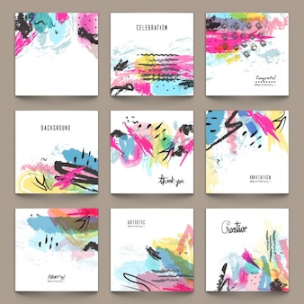 Assortment of invitation cards with colorful stains