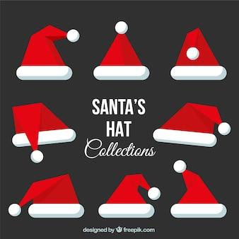 Assortment of santa hat in flat design