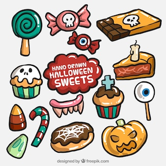 Assortment of sweets and hand-drawn halloween cakes