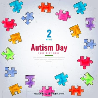 Autism day background with watercolor puzzle pieces