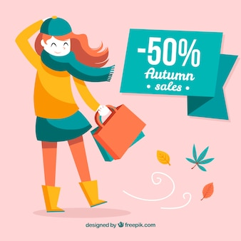 Autumn sale with woman in a windy day