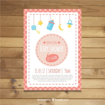 Baby shower invitation with elements hanging and frame in pink tones