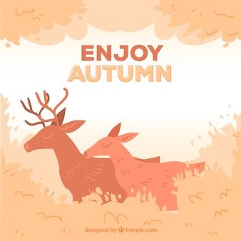 秋の風景を描いた手で鹿の背景