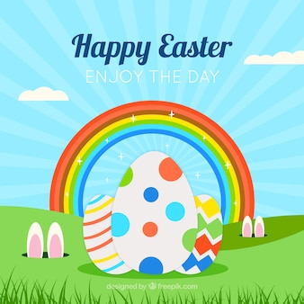Background of easter eggs on grass and rainbow