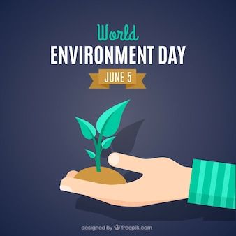 Background of environmental day hand with a plant