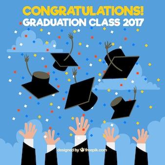 Background of graduation cap and confetti
