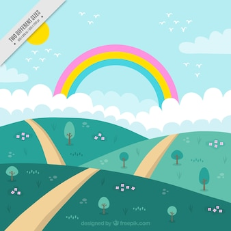 Background of hills with path and rainbow
