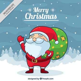 Background of lovely santa claus with a green sack