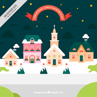 Background of pretty christmas village with a church