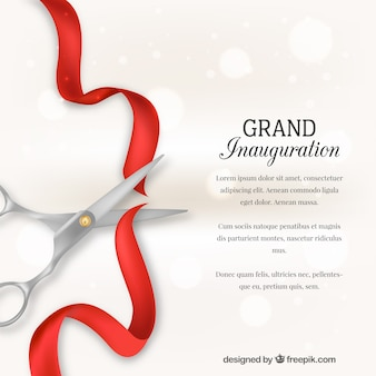 Background of scissors cutting a red ribbon