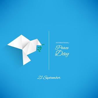 折り紙の平和の鳩と背景