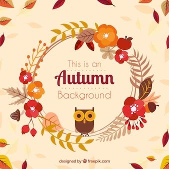 花のフレームには、フクロウと秋の背景