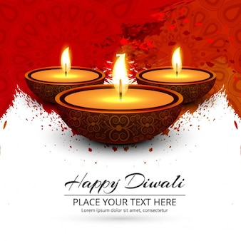 Background with red paint and candles for diwali