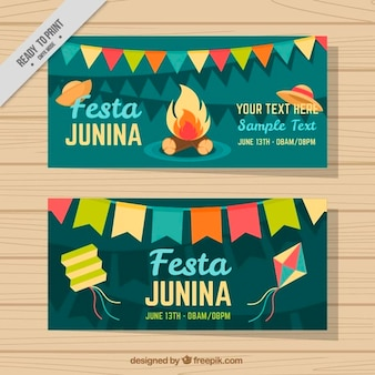 Banners of festa junina with decoration and bonfire