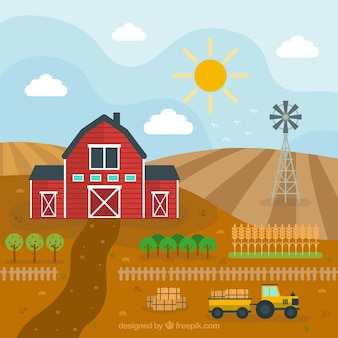 Barn and tractor in a farm landscape