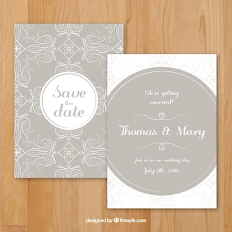 Beige wedding invitation with sketches floral decoration