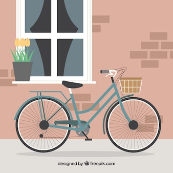 Bike with basket in front of cute house background