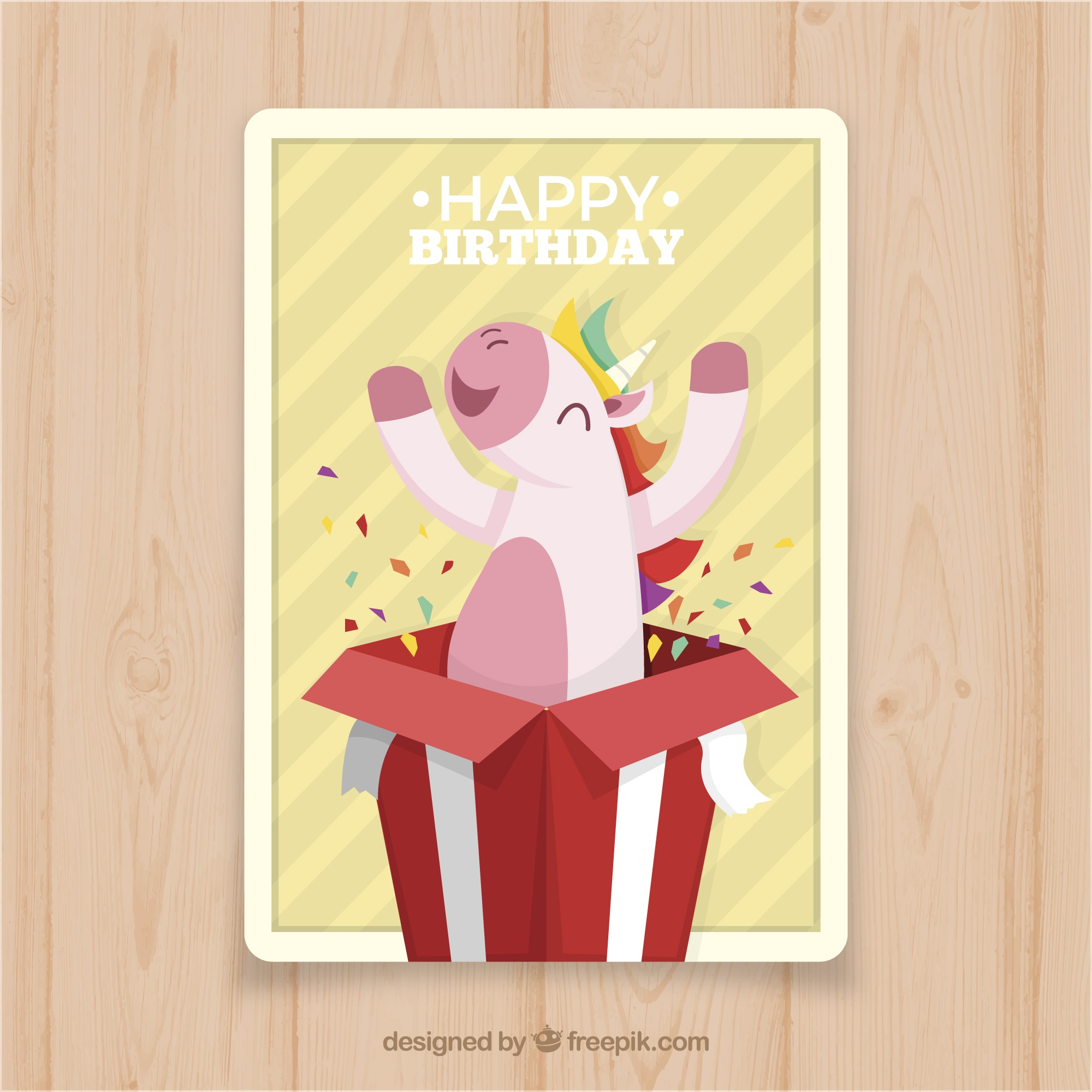 Birthday card with a unicorn coming out of a gift