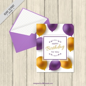 Birthday card with realistic balloons and envelope