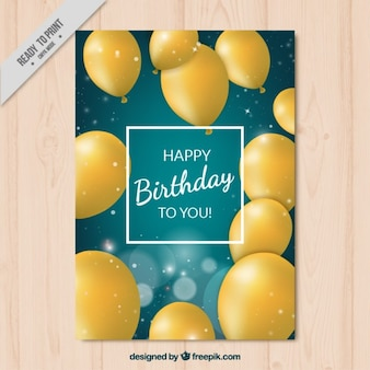 Birthday card with realistic yellow ballons