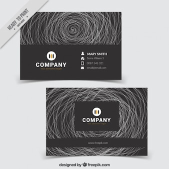 Black abstract business card with doodles