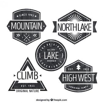 Black and white adventure badges