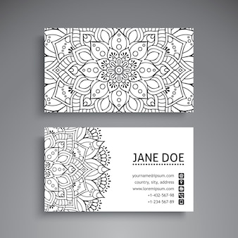 Black and white business card with mandala decoration