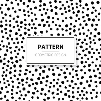 Black and white doodle pattern with dots