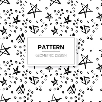 Black and white doodle pattern with stars and circles