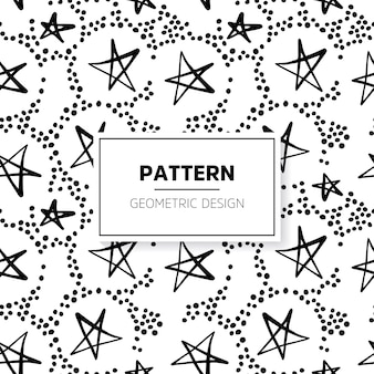 Black and white doodle pattern with stars and dots