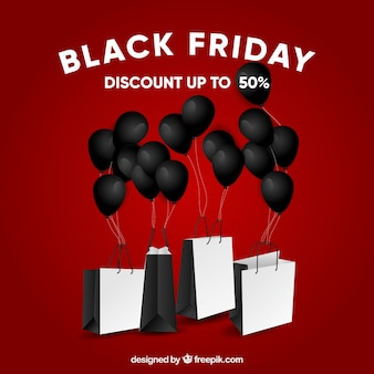Black friday design with balloons and bags