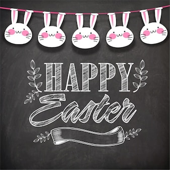 Blackboard background with garland of decorative rabbits