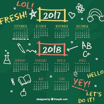 Blackboard school calendar with doodles