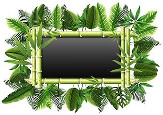 竹と緑の葉を持つ黒板