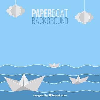 紙のボートで青と白の背景