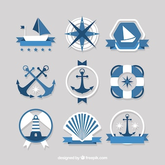 Blue and white badges with nautical items